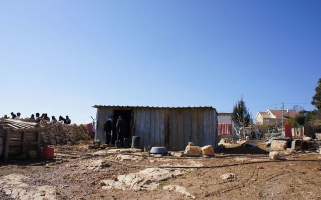 The rubble of a home demolished by the IDF, with a tin shack that a family now has to live in, in Umm al-Khair.