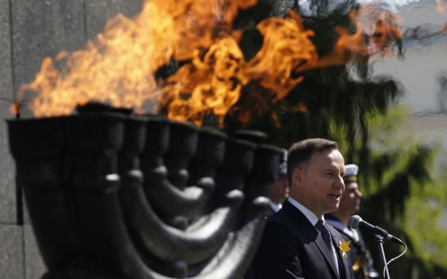 Poland's President Andrzej Duda speaks during state ceremonies in homage to the victims and fighters of the 1943 Warsaw Ghetto Uprising, on the 75th anniversary of the start of the revolt, in front of the Monument to the Warsaw Ghetto Heroes, in Warsaw, Poland,  (AP Photo/Czarek Sokolowski)