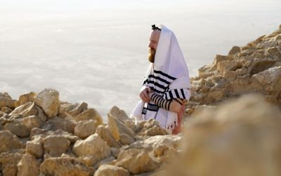 "A Cast member praying at the top of Masada in the programme, Kibbutz, in which eight British Jews ""go on a journey to examine some of the most pressing questions facing the Jewish community in 2018"", part of the new BBC2 season line up.    (Photo credit: Strahila Royachka/BBC/PA Wire)"