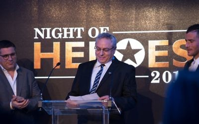 Dr Lior Sasson of Save A Child's Heart winning his award at Jewish News' Night of Heroes  Credit: Blake Ezra