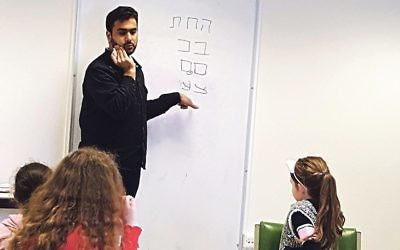 Zain teaches pupils the Hebrew alphabet at the Wimbledon cheder