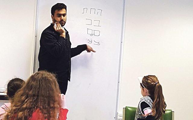 Zain teaches pupils the Hebrew alphabet at the Wimbledon cheder
