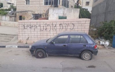 Example of a price tag vandalism attack  Credit: Yotam Berger on Twitter