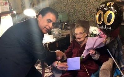 Shokat Ali surprised long-time Labour activist Edith Poulson with flowers and a special card to accompany her traditional greeting from The Queen.