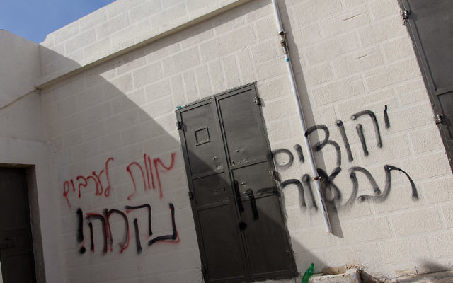 """Example of extremist graffiti on a Palestinian house outside Ma'ale Levona, which reads """"Jews Wake Up!"""", """"Death to the Arabs"""", """"Revenge!"""" (31 January 2014)"""