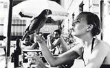 Shelagh Wilson with a parrot, Copacabana beach, 1951