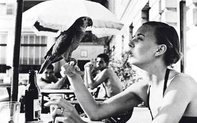 Shelagh Wilson with a parrot, Copacabana beach, 1951