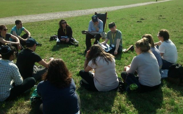 Richard Verber, sitting alongside Holocaust Survivor Harry Olmer, describing the layout of the Majdanek Death Camp
