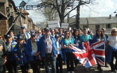 The UK Delegation walk through the entrance gate at Auschwitz during Thursday's March of the Living