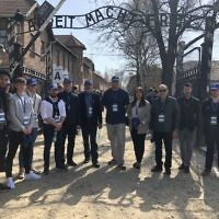 The Chelsea FC delegation at the gates of Auschwitz I