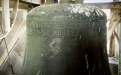 A swastika emblazoned on a bell in a church in the German town of Schweringen. (Screen capture/YouTube)