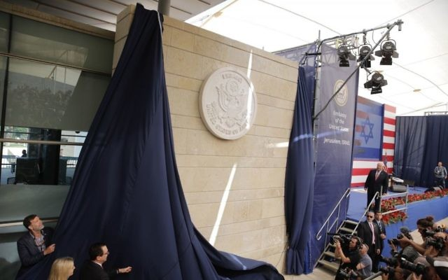 U.S. President Donald Trump's daughter Ivanka Trump, left, and U.S. Treasury Secretary Steve Mnuchin unveil an inauguration plaque during the opening ceremony of the new US embassy in Jerusalem, Monday, May 14, 2018.  . (AP Photo/Sebastian Scheiner)