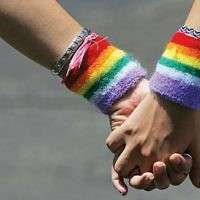 An image of rainbow sweat bands, evoking the LGBT pride flag
