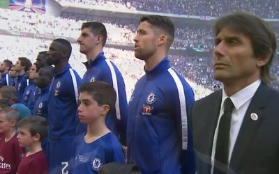 Jacob lines up during the playing of the national anthem prior to kick-off