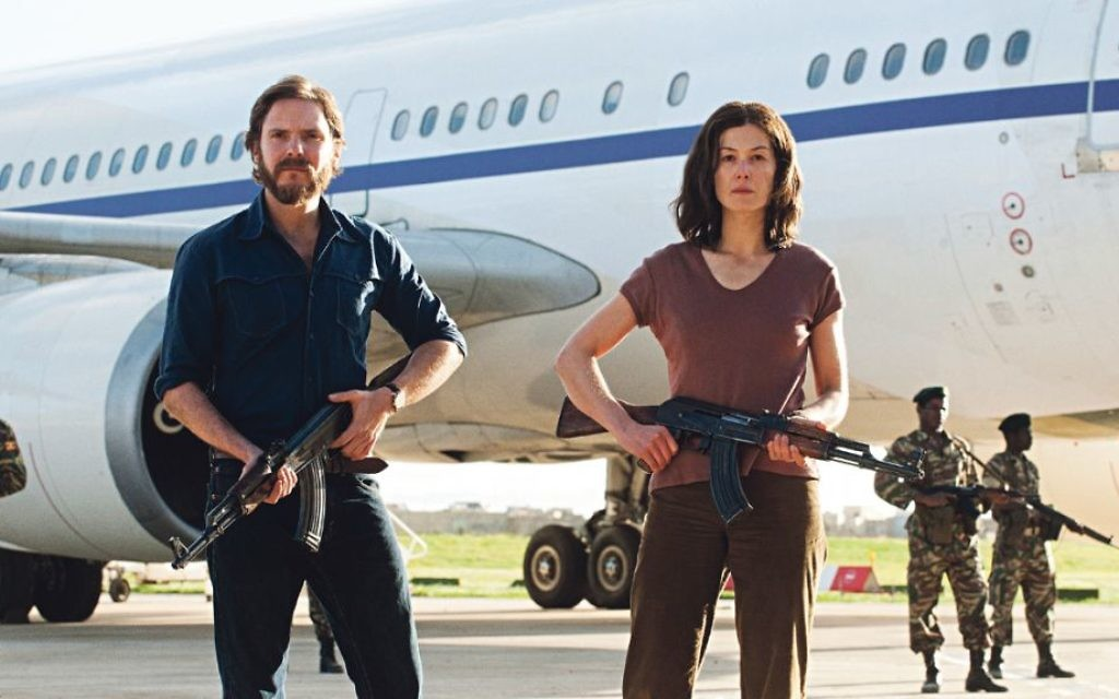 Daniel Brühl and Rosamund Pike, above, as German hijackers in Entebbe, directed by Brazilian José Padilha
