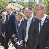 The Duke of Cambridge (second left) and Ephraim Mirvis (second right), chief rabbi in the UK, arriving at the Yad Vashem Holocaust Memorial and Museum in Jerusalem, Israel's official memorial to the Jewish victims of the Holocaust, as part of his tour of the Middle East.   Photo credit: Ian Vogler/Daily Mirror/PA Wire