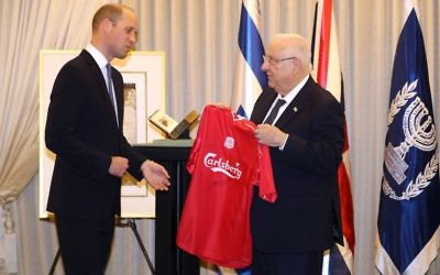 The Duke of Cambridge presents Israeli President Reuven Rivlin with a Liverpool FC shirt, signed by Steven Gerrard, during an audience at his official residence in Jerusalem, Israel.  Photo credit: Chris Jackson/PA Wire