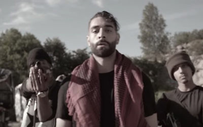 "Kaveh Kholardi appearing in the video for his song ""The Man"", 2017. (Screenshot from Youtube)"