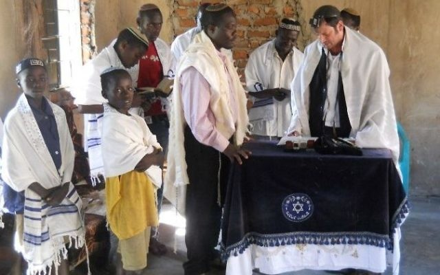 Local and foreign Rabbis pray in the synagogue of Puti next to Mbale