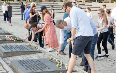 The group concluded their trip to Auschwitz by lighting memorial candles