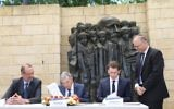 Sebastian Kurz and Yad Vashem's chair Avner Shalev signing the historic agreement.   Credit: @yadvashem on Twittr