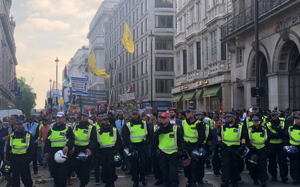 Hezbollah terror flags fly as marchers parade through the streets of London for the annual Al Quds Day march