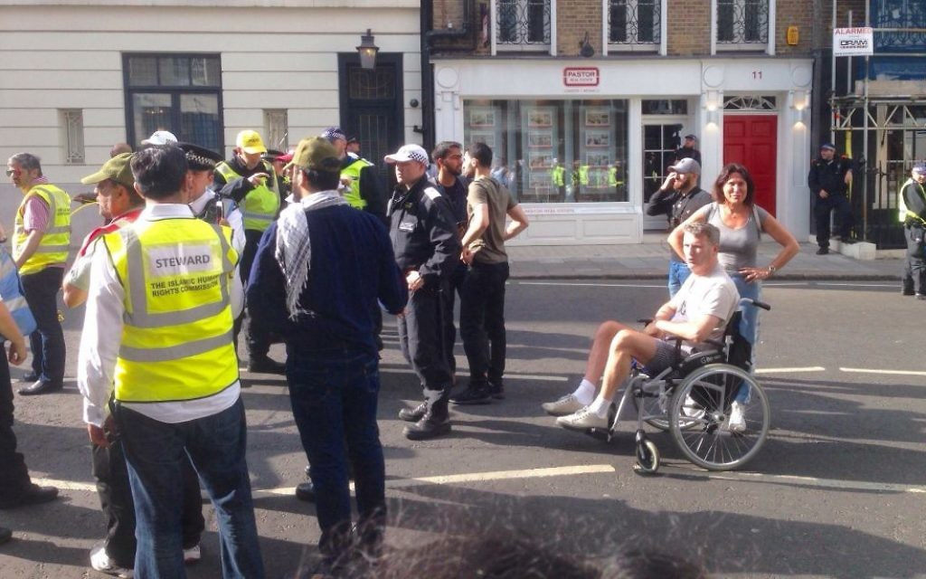 Mark Lewis in his wheelchair, forcing the pro-Hezbollah Al Quds Day march in central London