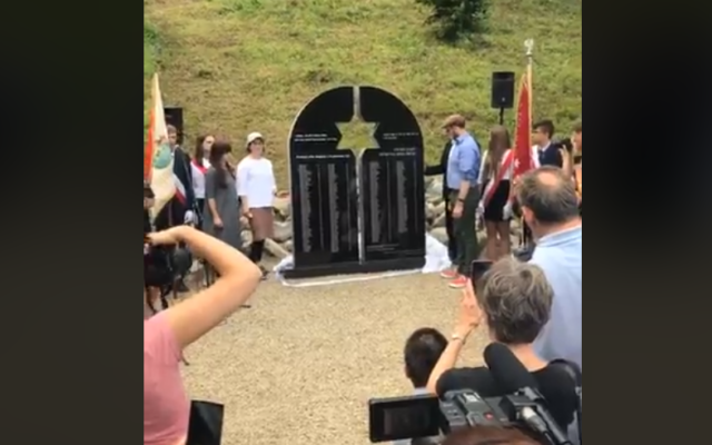 The monument being unveiled in Krościenko   Credit: Screenshot from Facebook video