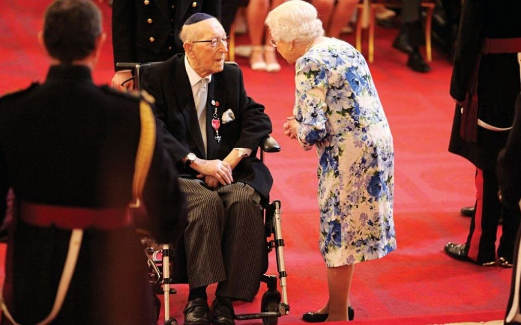 Lieutenant Colonel Mordaunt Cohen receiving his MBE from the Queen