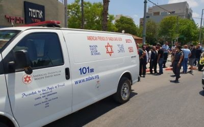 Emergency ambulance from Magen David Adom arrives at the seen of the stabbing