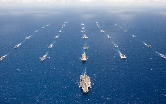 Official U.S. Navy file photo of ships and submarines participating in Rim of the Pacific in formation in the waters around the Hawaiian islands