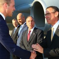 Israel's envoy to the UK Mark Regev greets Prince William at Ben Gurion