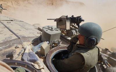 One of the new female IDF graduates on a tank