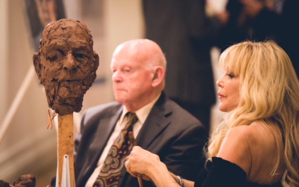 Frances Segelman sculpting Sir Ben Helfgott  Credit: Yad Vashem UK