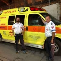 MDA staff with one of their ambulances