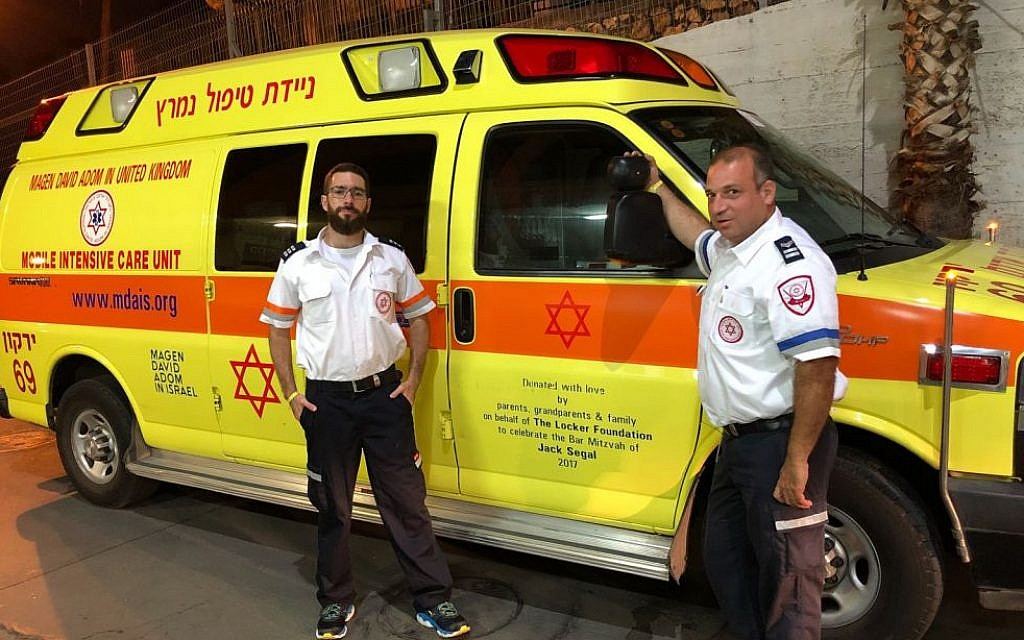 MDA staff in Israel with one of their ambulances