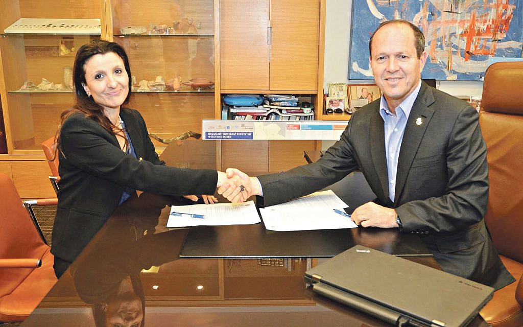 Great shakes: Fleur Hassan-Nahoum pictured with Nir Barkat
