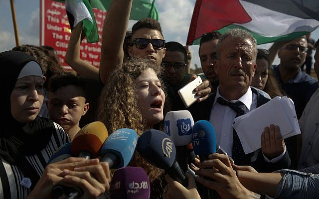 Ahed Tamimi speaks to the media after she was released by the Israel army in her village of Nebi Saleh in the West Bank  (AP Photo/Nasser Shiyoukhi)