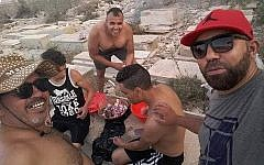 Men having a barbecue in the Sousse Jewish cemetery. Credit: Elie Trabelsi on Facebook