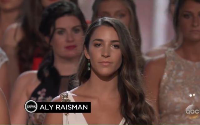 Aly Raisman speaking on behalf of 140 gymnasts at the awards.