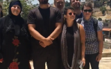 Left-wing Birthright participants with a family of Palestinians who are to be evicted from their house