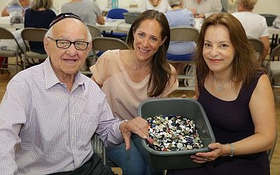 Zigi Shipper, Gabi Rolfe and Abigail Mann at the Bushey United Synagogue button count earlier this month