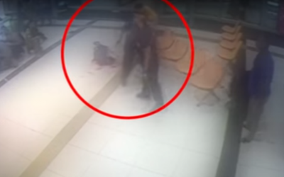 Screenshot of video from Haaretz shows the moment David Moyal uses a bench to kill Haftom Zarhum, 29
