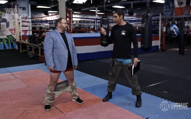 A screenshot from the episode of This Is America, in which Sacha Baron Cohen gets Georgia state representative Jason Spencer to drop his trousers and attack him with his backside.