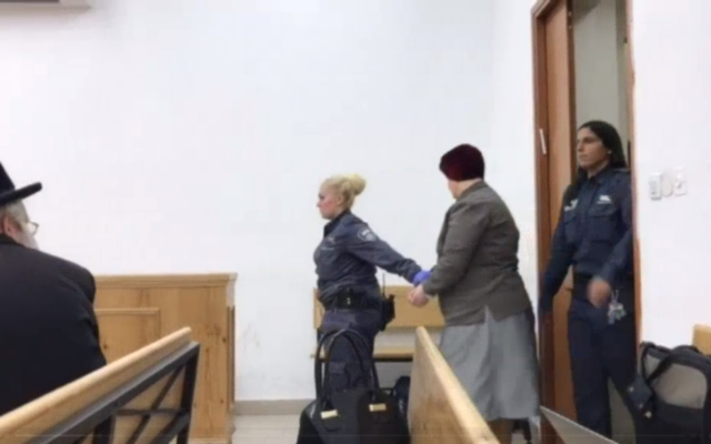 Malka Leifer entering the courtroom