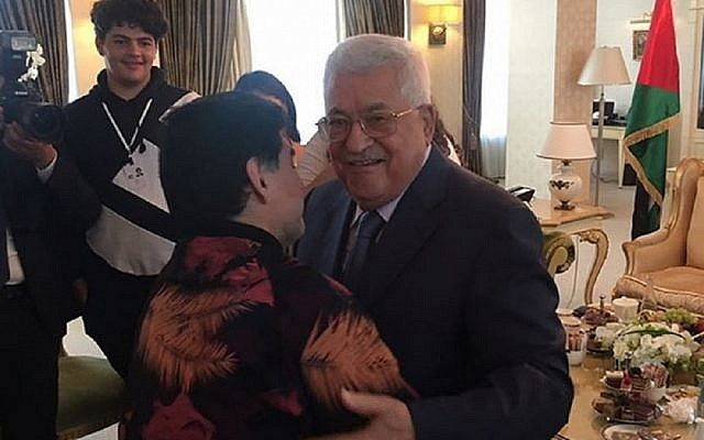 Diego Maradona embraces Palestinian Authority President Mahmoud Abbas