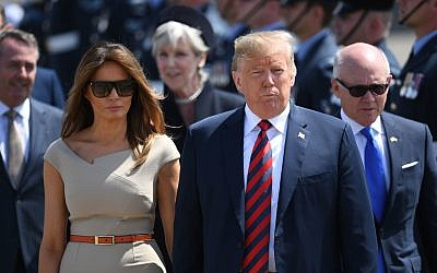US President Trump and Melania Trump, Woody Johnson, United States Ambassador to the United Kingdom (right) arrive at Stansted Airport, London, in Air Force One, for their first official visit to the UK.
