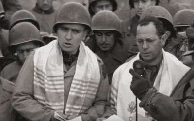 Max Fuchs, left, helped lead a historic service for Jewish-American soldiers in Aachen, Germany, in 1944. (Screenshot from YouTube)