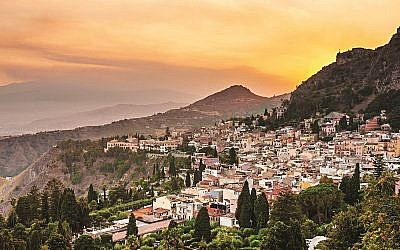 Taormina city and Etna volcano during a dramatic sunset in Sicily, Italy