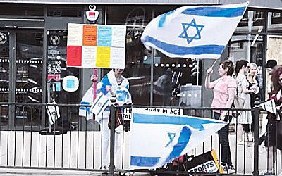 Pro Israel activists demonstrate outside the Co-Operative in Hampstead Garden Suburb